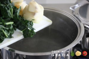 kale and potatoes into boiling water
